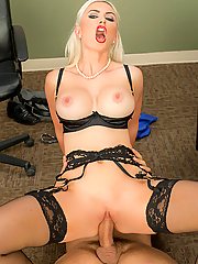 Gigi Allens plays with a thick cock and a big vibrator in the office