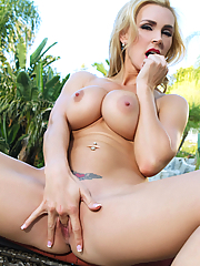 Tanya Tate fingering her bald snatch on the patio
