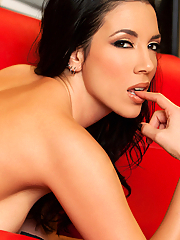Jelena Jensen probing her tasty snatch on the red couch
