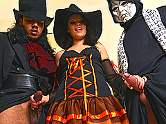 Even doctors enjoy Halloween, as you'll see here when Dr. Ava Dalush encounters two of her fellow freaky physicians in the form of Lance Hardwood and (behind the mask) Mugur. In the clinic, these healers get horny in their costumes, and after a little horseplay with a prosthetic arm, get down to the real concerns of this holiday... whether or not their big dicks are going to get blown! Well, naturally the answer is yes and Ava does a sterling job with the cock sucking. Looking supercute, she puts these goblins in her gullet, all the while a fetching sight in her costume. Kneeling, she moves back and forth between the rods, holding one in her hands as she sucks the other, and even trying to stuff both in her pretty face at the same time. The lucky lady gets her pussy eaten a little too, but in the end, it's time for her colleagues to squirt on Ava's tits and tongue as she sits between the medicos and tugs their tools to a finish.