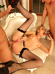 Melanie Taylor gets her ass drilled by two hung studs