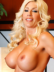 Puma Swede fingering her pink snatch on the black couch