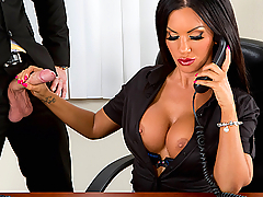 When you're a perfect slutty secretary like Elicia Solis, you can handle distractions such as your boss strutting into your office, undoing your blouse and playing with your big juicy tits. While Elicia fielded a phone call, Closer put his mouth on her perky hard nipples, then offered her a big hard cock to suck on. When it was Clover's turn to pick up the phone, he had his hand up Elicia's skirt, fingering that British's slut perfect pussy until she was super horny to fuck. Clover nailed that bronzed babe on his desk, and even took up his belt to give her juicy butt a good spanking before pounding her hole again!