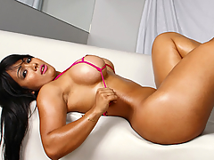 Akemy liked to rub men down in oil before she sat on their dicks. She also liked to tease them with her huge knockers and rub her big tits all over them. Some chicks didn't really get into much sucking dick, but Akemy loved doing the deed while squeezing her mighty tits and spreading her huge ass. This shawty Brazilian chick got it good. Her ass went on for days, and we get to see her take a dick in in some crazy hot anal too. That cock just disappeared in her huge hungry ass!