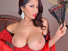 Susana Alcala is a magnificent MILF from Spain, and she brings along a pair of bodacious knockers in the bodice of her elegant dress that are going to get your mouth watering pronto! Flirting first behind her fan, Susana then shares her cleavage in the front of her lacy red frock, but she doesn't torture us for long, soon pulling down the fabric to reveal her big nipples and the deep shadow of her cleavage. You'll just wanna dive right into those juggs! Savor the big tits porn fun as these big natural boobs dazzle your eyes, hanging free and jiggly in the front of her dress. She rubs her fan between them, then sits down on the chair to show us her snatch and to press the handle of the fan into her very pink core. Her red-polished fingertips probe her slit and spread it wide, and at the same time she lifts her heavy hooters to her scarlet-lipsticked mouth to lick at her nip.