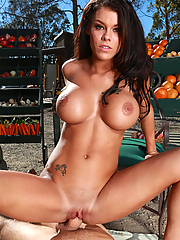 Peta Jensen seduces a customer with her juicy juggs