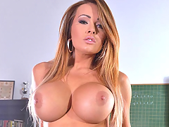 Imagine Miss Charley Atwell as your adult education teacher! You enter the classroom and find this busty pornstar in her nylon stocking finery, ready to start her lecture in topics like big breast sex, big tits porn, and the amount of time horny boys like us should spend studying it... a lot! Funny though, you're the only pupil! You see, Miss Atwell believes in one-on-one coaching, so your attention can't possibly wander! Not that it would! Indeed, Miss Atwell has an unusual approach to presenting her material, whether it be her big knockers in their pink satin and black lace boulder-holder, or the cleavage of her bells pushed up in the cups, or the cleavage of her ass-cheeks when she tugs down her thong right before your goggling eyes. Miss Atwell doesn't stand at a blackboard to make her points. Instead, she reclines on the table to pancake her paps, kneels over to give you the sway and jiggle of her bells, and sits up to push her naked knobs toward you with her upper arms, so you'll never, ever, forget her lecture! Not that you possibly could in a million trillion years!