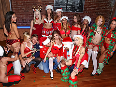 It's the time of the year for Holiday Parties, but those won't have shit on this In the VIP XXXmas Party. Led by Sydney Cole, this rowdy group of Christmas vixens were all naughty but more than ready to get nice in this sex party. There were plenty of our favorites, including Adrian Maya, Alaina Kristar, Ava Sanchez, Darcie Belle, Kassondra Raine, Kate England, Layna Landry, Lilli Dixon, Mia Monroe... They were all in tiny red bikinis and thongs with Santa caps, reindeer antlers headbands, and mistletoe wrapping. After showing off their beautiful tits, asses and pussies, these ladies went wild on each other, on Levi, and on Seth, as they ate pussy and sucked cock. Who could ask for a better Xmas gift? But it didn't end there. The guys really dicked the halls, as they banged these ladies all over the club, and switched off between them, until they were busting their creamy eggnog into all their mouths.