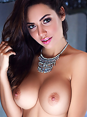 Adrienn Levai reveals her impressive breasts in the bedroom