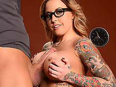 When Xander and his girlfriend Becky came to her office to announce their plans to drop out, teacher Payton West decided to show Xander how a real pro treats a good dick. After putting a hand down the front of his pants, Payton discovered how big her student's cock was, and knew she needed to have it inside her then and there. Right there in front of his girlfriend, Xander let Ms. West suck his cock and slid his rod between her big fat tits. Then Xander bent her over the desk and plowed Payton's tight pussy from behind. Once she'd had a taste of his dick, Payton rode that rod, and even gave Xander a footjob between her stockinged feet!
