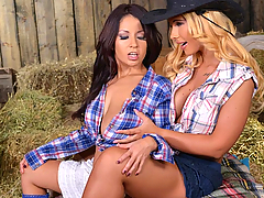 Busty pornstars Kyra Hot and Susana Alcala are hanging out in a barn. Soon enough they focus their attention on where we would focus ours if we were lucky enough to be there. Yes, it's time for big tits lesbian action as these two stunningly endowed honeys fondle their juggs through their low-cut plaid halter tops and then take out their heavy hooters for sucking and rubbing. The ladies swap spit and lick clit as their clothes are pulled aside, and Kyra fastens her mouth onto Susana's juggs while Susana enjoys the Kyra's tits. Then adventurous Kyra finds two kitchen items in the barn, a long wooden rolling pin and a metal egg beater, which are quickly put to use! Susana gives the rolling pin a good titty-fuck, then she feels the handle of the egg beater rubbed on her snatch. But that rolling pin is the real attraction for both babes, as they boff their pussies with it simultaneously, double-dong style!