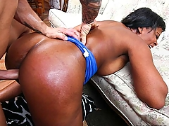 Monique Symone is a thick all-natural ebony beauty with great tits. She came over to give Derrick a birthday surprise of cake and her juicy phat ass, but he wasn't around, so I got her to give us a little preview. She showed me her huge black boobs and shook her ass. She even let me decorate her breasts with frosting. That's when Derrick walked in, confused, but he calmed down once Monique dropped to her knees. She can suck a dick like no other. She was deepthroating and face-fucking herself. She also gave the birthday boy a stripper level lap dance. Derrick banged her pussy hard as fuck, and she loved it. Talk about a screamer. Actually, talk about an awesome birthday present!