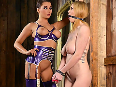 Tasha Holz is under the control of Mistress Anna Polina in this extreme lesbian bondage roleplay, as the statuesque blue-eyed raven-tressed babe keeps the blonde babe bound, gagged, and pinches her nipples and spits in her face. Clothespins on Tasha's nipples guarantee further arousal, and then Mistress Anna pours red and white candle wax down Tasha's hooters! But Tasha's punishment is only beginning, as dominatrix Polina puts her slave on a chair, clamps her shaved pussy lips open with yet more clothespins, and pours candle wax all over her feet. Then she requires her sub to lick her pussy once the gag has been removed.  Rewarding Tasha for the cunnilingus, Mistress Anna then bends her slave over the chair in the doggie position and pours red and white candle wax all over her soles and butt cheeks. She then gives Tasha a spanking, right on the drying pools and rivers of wax that cover her fanny and feet...