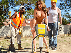 When Richelle Ryan got cat-called by some asshole construction workers, she decided to call their bluffs by hiking up her skirt, shaking her thick booty, and telling them to whip out their big cocks. Unfortunately for her, just as she was starting to really get horny, their boss Johnny Sins told them to get back to work! Never one to take no cock for an answer, Richelle marched into Johnny's office and demanded he'd satisfy her wet pussy! She sucked and fucked his fat dick, even getting pounded from the back while she was locked up in Johnny's kinky sex stocks! Once she was finally satisfied, she marched out to take the jackhammer for a test drive, making her big fake tits and amazing booty bounce beautifully!