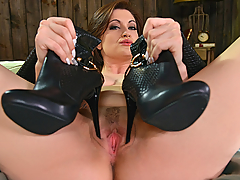 When we first come upon Brook Scott in her new Full HD foot fetish XXX video, she looks rather domineering with her riding pants, high heel boots, and riding crop, but it turns out this blue-eyed hot babe is more into having flirty fun with us! Taking off her boots and giving them a good sniff, she reveals her bare feet, which she kept in the boots with no socks. She flexes her soles, gives herself a toe sucking, and rubs them against her big boobs. Holding her riding crop between her toes, she uses it to spread her pink with the little black horse's head on the handle. Enjoy Brook's wonderful high arches and indulge in foot worship today!