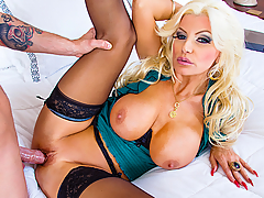 Brittany Andrews is a hot and horny cougar that's ready to take on the next dick she sees. Lucky for Axel, that dick happens to be his!