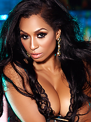 Karlie Redd seduces in a sexy corset and high boots
