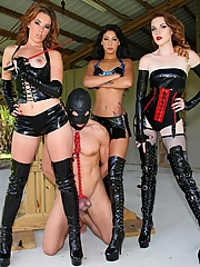 Mistresses Lizzie Tucker, Esmi Lee and Deanna Storm with a tied up slave ready to CBT his balls