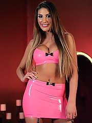 Mistress August Ames looks hot in her pink latex with a chastised slave on her leash