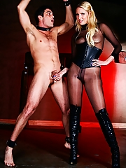 Mistress Vanessa Cage punishes her slave's balls for her amusement.
