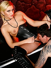 Mistress Caprice Capone teases her slave with her pussy, then puts him to work worshipping it
