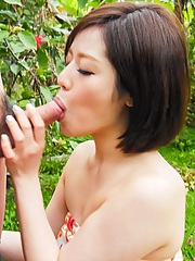 Minami Asano Asian licks and sucks woody in garden till gets cum