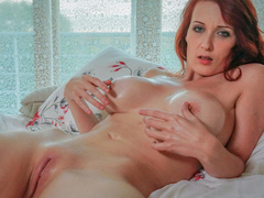Lovely big-titted redhead Isabella Lui strips down for an intense masturbation session.She lies on her back in bed and covers her sweet pussy with oil massage before putting that powerful sex toy to work and masturbating till climax. (Video duration: 19 minutes)