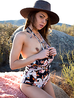 Drew Catherine strips nude in the wild outdoors