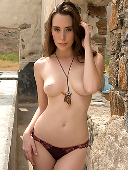 Willa Prescott strips nude in the streets of an abandoned village