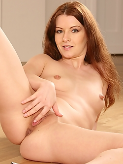 Small breasted redhead Lena Love toying her wet pussy.