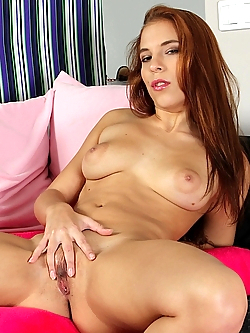Gorgeous busty babe Candy Belle spreads tight pussy.