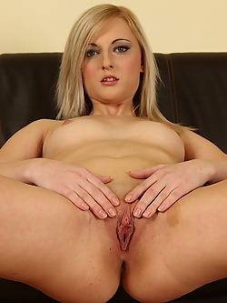 Katy Rose licks her tits and fingers her wet pussy.