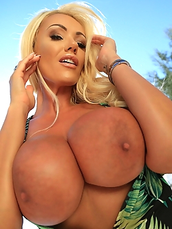 Lucy Zara poolside under the sun show us her big tits