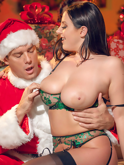 Angela White rides Santa's big fat dick by the Christmas tree