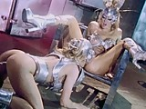 This clip from Hell on Heels by Wicked Pictures features Jenna Jameson in a futuristic fembot sex scene a wired up silver gynoid fucking the other cyberslut with anal beads and her fingers.