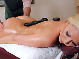 Devon Lee is interested in trying a different kind of massage. She wanders into Jordan's massage parlor and asks for a hot stone treatment, completely unaware of what it entails. After some routine rubbing, Jordan places hot stones on her body and tells her not to move. His hands explore her naked, oiled up ass and he rubs her pussy with one of the stones. Devon goes from creeped out to turned on, letting him fuck her hard and cover her face in hot cum.